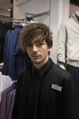 Young shopworker, Debenhams, Stratford upon Avon, Warwickshire - John Harris - 2010s,2016,adolescence,adolescent,adolescents,apparel,assistant,assistants,boy,boys,child,CHILDHOOD,children,clothes,clothing,Debenhams,Department store,EARNINGS,EBF,Economic,Economy,Emilio,employee,e