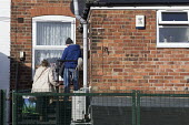 Family going into their flat, Shirebrook, Derbyshire - John Harris - 2010s,2016,Diaspora,eastern european,eu,european,europeans,families,Family,flat,flats,foreign,foreigner,foreigners,Housing,immigrant,immigrants,immigration,male,man,men,migrant,migrants,migration,peop