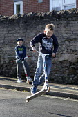 Boy performing stunts and tricks on his scooter, Shirebrook, Derbyshire - John Harris - 13-11-2016
