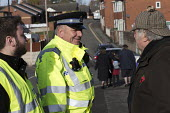 PCSO Steve Cathcart and Polish interpreter, Shirebrook, Derbyshire - John Harris - 2010s,2016,bilingual,CLJ,community policing,force,interpreter,Interpreters,male,man,men,OFFICER,officers,older,patrol,patrolling,PCSO,pcsos,people,person,persons,POLICE,Police Officer,policeman,police