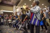 Oakland, California. Protest inside a branch of CItibank who have financed the Dakota Access Pipe Line by activists opposing construction and in solidarity with the Standing Rock Sioux water protector... - David Bacon - 10-11-2016