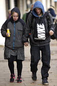 Stressed homeless couple holding hands, Leamington Spa, Warwickshire - John Harris - 2010s,2016,adult,adults,care,caring,comforting,communicating,communication,conversation,conversations,couple,COUPLES,cry,crying,despondent,destitute,dialogue,discourse,discuss,discusses,discussing,dis