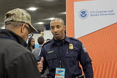 Detroit, Michigan. Young African American talking to a recruiter from US Customs and Border Protection Agency at a job fair sponsored by the nonprofit My Brother's Keeper - Jim West - African Americans,2010s,2016,African,African American,Agency,America,american,americans,application,applying,BAME,BAMEs,black,BME,bmes,career,CAREERS,charitable,charity,choice,choices,choosing,communi