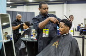 Detroit, Michigan: Young African American men having their hair cut, ob fair sponsored by the nonprofit My Brother's Keeper - Jim West - African Americans,2010s,2016,African,African American,African-American,America,american,americans,application,applying,BAME,BAMEs,barber,black,BME,bmes,career,CAREERS,charitable,charity,choice,choices