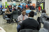 Detroit, Michigan. Young African American men practicing their interview skills at a job fair sponsored by the nonprofit My Brother's Keeper - Jim West - African Americans,2010s,2016,Adult Education,African,African American,African-American,America,american,americans,application,applying,BAME,BAMEs,black,BME,bmes,career,Career Advice,CAREERS,charitable