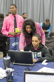 Detroit, Michigan. Young African American man getting help in preparing his CV at a job fair sponsored by the nonprofit My Brother's Keeper - Jim West - 14-11-2016