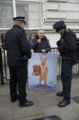 Artist Kaya Mar with a new Philip Hammond MP painting taliking to Police, Autumn Statement, Westminster, London - Jess Hurd - 2010s,2016,ACE,adult,adults,art,Artist,artists,arts,artwork,artworks,Autumn,Autumn Statement,AUTUMNAL,caricature,CONSERVATIVE,conservative Party,Conservatives,culture,Kaya Mar,London,male,man,MATURE,m