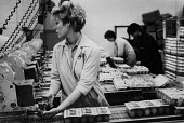 Women workers packing eggs, Goldenlay egg factory, Southport - Denis Doran - 1980s,1985,by hand,capitalism,EARNINGS,egg,eggs,FACTORIES,factory,FEMALE,food,Food Processing Industry,FOODS,Income,Industries,industry,inequality,living wage,Low Pay,Low Income,low paid,Low Pay,packe