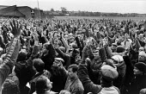 Mass meeting of thousands of car workers on strike at Land Rover in a pay dispute, Solihull, Birmingham 1988 - John Harris - 1980s,1988,AEU,Birmingham,car worker,car workers,democracy,dispute,disputes,divided,division,Hands up,INDUSTRIAL DISPUTE,Land,male,man,Mass,Mass Meeting,mass meetings,meeting,MEETINGS,member,member me
