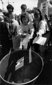 Public illegally burning Poll Tax registration forms in protest at the Community Charge, Bristol 1990 - John Harris - 1990,1990s,activist,activists,against,burn,burning,BURNS,CAMPAIGN,campaigner,campaigners,CAMPAIGNING,CAMPAIGNS,civil disobedience,communities,Community,DEMONSTRATING,Demonstration,DEMONSTRATIONS,FEMAL