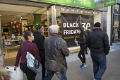 Black Friday shoppers, Oxford Street, London. - Philip Wolmuth - 2010s,2016,bag,bags,BAME,BAMEs,black,BME,bmes,bought,business,buy,buyer,buyers,buying,cities,City,commodities,commodity,consumer,consumerism,consumers,consumption,customer,customers,diversity,EBF,Econ