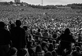 Fans and crowd at The Who concert 1976 , Charlton football ground, Charlton, South East London - Martin Mayer - 1970s,1976,adolescence,adolescent,adolescents,audience,AUDIENCES,Charlton,Charlton football ground,cities,City,concert,concerts,crowd,crowded,fan,fans,football,Leisure,LFL,LIFE,London,male,man,melody,