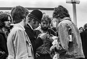 Police checking for forged tickets outside a The Who concert 1976, Charlton football ground, Charlton, South East London - Martin Mayer - 1970s,1976,adolescence,adolescent,adolescents,adult,adults,audience,AUDIENCES,Charlton,Charlton football ground,check,checking,cities,City,CLJ,concert,concert ticket,concerts,crime prevention,evidence