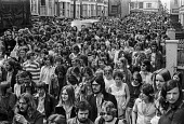 Fans arriving for a The Who concert, 1976 Charlton footbal ground, Charlton, South East London - Martin Mayer - 1970s,1976,adolescence,adolescent,adolescents,ARRIVAL,arrivals,arrive,arrives,arriving,audience,AUDIENCES,cities,City,concert,concerts,crowd,crowded,denim,FACE,faces,fan,fans,FEMALE,Leisure,LFL,LIFE,L