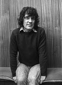 Alex Harvey (L) of The Sensational Alex Harvey Band backstage 1976 at The Who concert, Charlton football ground, South East London - Martin Mayer - 1970s,1976,Alex Harvey,backstage,Band,bands,Charlton football ground,concert,concerts,football,London,male,man,melody,men,music,MUSICAL,musician,musicians,people,person,persons,player,players,Pop musi
