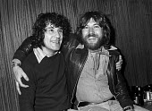 Alex Harvey (L) of The Sensational Alex Harvey Band 1976 with his drummer Ted McKenna, backstage at The Who concert at Charlton football ground, South East London - Martin Mayer - 31-05-1976