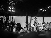The Who playing at Charlton football ground 1976 (L-R) John Entwistle, Roger Daltrey and Pete Townsend - Martin Mayer - 1970s,1976,audience,AUDIENCES,Charlton football ground,cities,city,concert,concerts,football,guitar,guitars,John Entwistle,Leisure,LFL,LIFE,male,man,melody,men,music,MUSICAL,musical instrument,musical
