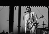 Pete Townsend playing at a The Who concert, 1976, Charlton football ground, South East London - Martin Mayer - 31-05-1976