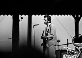 Pete Townsend playing at a The Who concert, 1976, Charlton football ground, South East London - Martin Mayer - 1970s,1976,Charlton football ground,cities,city,concert,concerts,football,guitar,guitars,Leisure,LFL,LIFE,London,male,man,melody,men,music,MUSICAL,musical instrument,musical instruments,musician,music