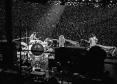 The Who playing at Charlton football ground 1976 (L-R) Pete Townsend, Roger Daltrey and John Entwistle - Martin Mayer - 1970s,1976,audience,AUDIENCES,Charlton football ground,concert,concerts,football,guitar,guitars,John Entwistle,Leisure,LFL,LIFE,male,man,melody,men,music,MUSICAL,musical instrument,musical instruments