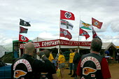 Hells Angels bikers 22nd annual Bulldog Bash motorcycle gathering, Long Marston. Nazi flags at the The Stolen Tool Company stall - Justin Tallis - 2000s,2008,ACE,Angels,Arts,bigotry,bike,bulldog bash,Company,Culture,DISCRIMINATION,emblem,equal,equality,event,FACISM,FACIST,far right,far right,fascism,fascist,Fascists,festival,FESTIVALS,flag,flags