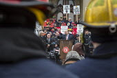 Lansing, Michigan USA Firefighters protest against austerity cuts to retirement and health benefits. The bills were withdrawn by the Republican until the 2017 legislative session. State Sen. Curtis He... - Jim West - 06-12-2016