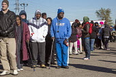 River Rouge, Detroit, Michigan, Hundreds of poor Americans wait in line for free turkeys and food parcels - Jim West - 2010s,2016,African American,African Americans,African-American,age,ageing population,aid,America,anger,angry,assistance,BAME,BAMEs,black,BME,bmes,charitable,charity,Christmas,cities,City,Detroit,disab