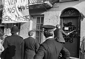 Police and baliffs evicting squatters, London 1979 - NLA - 1970s,1979,activist,activists,adult,adults,bailiff,bailiffs,banner,banners,Breaking and entering,campaign,campaigner,campaigners,campaigning,CAMPAIGNS,cities,City,CLJ,DEMONSTRATING,Demonstration,DEMON
