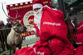 CWU Post Office strike protest with Santa Claus and reindeer, 50,000 Post Office in Crisis postcards are delivered to the Department for Business, Victoria Street, London - Jess Hurd - 2010s,2016,activist,activists,against,banner,banners,Business,BusinessDepartment for Business,CAMPAIGN,campaigner,campaigners,CAMPAIGNING,CAMPAIGNS,costume,costumes,crisis,CWU,deliver,delivered,DELIVE