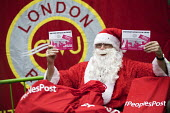 CWU Post Office strike protest with Santa Claus, 50,000 Post Office in Crisis postcards are delivered to the Department for Business, Victoria Street, London - Jess Hurd - 19-12-2016