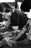 Travellers children at a site under the Westway having their blood tested for levels of lead poisoning caused by living in too close proximity to one of the major roads into central London, 1979 - Ian McIntosh - ,1970s,1979,air pollution,Air Quality,BAME,BAMEs,blood,blood test,blood testing,BME,bmes,boy,boys,caravan,child,CHILDHOOD,children,cities,City,diagnosis,diversity,doctor,doctors,ENI,environment,Enviro