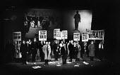 UK Premiere of The Rise And Fall of The City of Mahagonny by Bertolt Brecht Sadlers Wells Theatre London 1963 with set design by Ralph Koltai projecting images of Lenin and Stalin onto a screen behind... - Alex Low - 16-01-1963