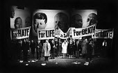 UK Premiere of The Rise And Fall of The City of Mahagonny by Bertolt Brecht Sadlers Wells Theatre London 1963 with set design by Ralph Koltai projecting images of world leadesr onto a screen behind th... - Alex Low - 16-01-1963