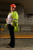 Pregnant woman transport manager at work, Pont LEveque, France - Benoit Decout - 2010,2010s,adult,adults,EBF,Economic,Economy,EMOTION,EMOTIONAL,EMOTIONS,employee,employees,Employment,eu,Europe,european,europeans,eurozone,Expectant Mother,FEMALE,france,french,happiness,happy,job,jo