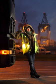 Woman HGV container transport driver, port of Le Harve - Benoit Decout - 2010s,2011,boat,boats,cargo,container,containers,crane,cranes,distributing,distribution,driver,drivers,driving,EBF,Economic,Economy,EMOTION,EMOTIONAL,EMOTIONS,employee,employees,Employment,eu,Europe,e