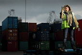 Woman HGV container transport driver, port of Le Harve - Benoit Decout - 2010s,2011,boat,boats,cargo,container,containers,distributing,distribution,driver,drivers,driving,EBF,Economic,Economy,EMOTION,EMOTIONAL,EMOTIONS,employee,employees,Employment,eu,Europe,european,europ