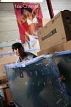 Woman storekeeper, Ford dealership, Herouville Saint Clair, France - Benoit Decout - 24-11-2010