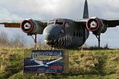 1952 Sea Prince aircraft wreck at the enternce to Long Marston Airfield, to be a Garden Village housing development, Warwickshire. Flying lessons in gliders sign - John Harris - 04-01-2017