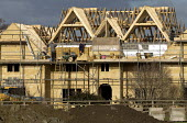 New Mansion under construction in Cotswold stone near Long Marston, Warwickshire - John Harris - 2010s,2017,AFFLUENCE,AFFLUENT,Bourgeoisie,bricklayer,bricklayers,bricklaying,builder,builders,building,Building Worker,buildings,Construction Industry,development,EARNINGS,EBF,Economic,Economy,elite,e
