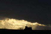 House, tree and dark clouds as the sun sets over a farm, Alcester, Warwickshire - John Harris - 2010s,2017,AGRICULTURAL,agriculture,bleak,building,buildings,CLIMATE,cloud,clouds,cold,conditions,cottage,cottages,country,countryside,cumulus,Cumulus Cloud,dark,darkness,dusk,EBF,Economic,Economy,ENI