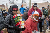 Detroit, Michigan USA Members of the Teamsters and AFL-CIO unions package holiday food boxes for distribution to the unemployed and underemployed. - Jim West - 2010s,2016,adolescence,adolescent,adolescents,AFL CIO,African American,African Americans,aid,America,assistance,BAME,BAMEs,black,BME,bmes,box,boxes,boy,boys,charitable,charity,child,CHILDHOOD,children