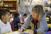 Thoreau, New Mexico - Teacher Denise Whelan works with a student in a kindergarten classroom at St. Bonaventure Indian School, a Catholic school on the Navajo Nation. - Jim West - 12-10-2016