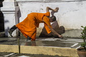 Laos, Luang Prabang, Monks rebuilding a temple - David Bacon - 2010s,2015,Asia,asian,asians,Belief,Buddha,Buddhism,buddhist,buddhists,build,building,buildings,construction,Construction Industry,Construction Workers,conviction,employee,employees,Employment,faith,G