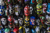 Wrestling masks on sale, San Juan de Dios Municipal Market, Mexico - David Bacon - 2010s,2016,americas,buy,buyer,buyers,BUYING,CHILD,CHILDHOOD,children,commerce,commodities,commodity,covered market,EBF,Economic,Economy,game,goods,juvenile,juveniles,kid,kids,Latin America,lucha libre