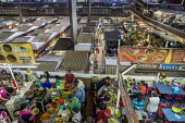 San Juan de Dios Municipal Market, Mexico - David Bacon - 2010s,2016,americas,bought,buy,buyer,buyers,buying,catering,CHILD,CHILDHOOD,children,commerce,commodities,commodity,consumer,consumers,cook,COOKS,covered market,customer,customers,DINNER,DINNERTIME,ea