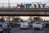 California, USA, AT&T Workers Demonstrate for a Union Contract. Memberes of CWA Local 9415 wave placards and hang banners on the overpass during the rush hour - David Bacon - 2010s,2016,activist,activists,AFL CIO,AFL-CIO,America,American,americans,AT&T,ATT,banner,banners,California,CAMPAIGN,campaigner,campaigners,CAMPAIGNING,CAMPAIGNS,communicating,communication,contract,C