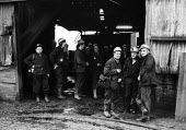 Miners preparing to go on shift and underground, Morlais Colliery, South Wales, 1973 - Chris Davies - 1970s,1973,capitalism,capitalist,coal,Coal Industry,Coal Mine,coalfield,coalindustry,collieries,colliery,EBF,Economic,Economy,employee,employees,Employment,extracting,hard hat,hard hats,Industries,ind