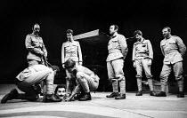 Man Is Man by Bertolt Brecht, Royal Court Theatre, London 1971 Henry Woolf, on floor, Bob Hoskins (C) - Chris Davies - 01-03-1971