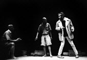 Playwright and director, Athol Fugard (R) on the set of his play, The Island, The Royal Court Theatre, London 1973 - Chris Davies - 1970s,1973,ACE,act,acting,actor,actor actors,actors,Arts,Athol Fugard,BAME,BAMEs,Black,BME,bmes,cities,city,Court,Culture,diversity,drama,DRAMATIC,ethnic,ethnicity,London,male,man,men,minorities,minor