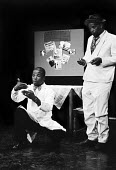 John Kani as Styles Buntu and Winston Ntshona as Sizwe Banzi (R) in Sizwe Banzi Is Dead by Athol Fugard The Royal Court Theatre, London, 1973 - Chris Davies - 1970s,1973,ACE,act,acting,actor,actors,Arts,BAME,BAMEs,black,BME,bmes,cities,city,Court,Culture,Dead,diversity,drama,DRAMATIC,ethnic,ethnicity,John Kani,London,male,man,men,minorities,minority,people,